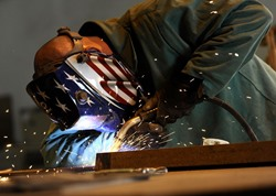 Tulare SD welder working in construction